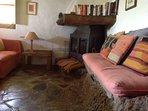 Wood burning stove in open plan kitchen/ sitting room