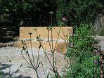 Seating on mosaic terrace with scabious flowering