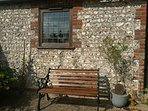 Relax outside the 200 year old flint barn