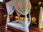 Yellow Orchid Room bed and canopy