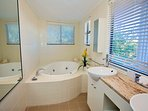 Ensuite bathroom with spa bath