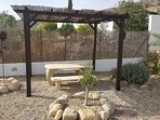 Gazebo with stone table and seating