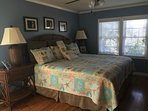 Master bedroom with comfy king size bed. Also has 32' flat screen TV. Lots of extra room.