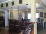 Bar area in between dining room and living room for casual seating. Nice open concept in the space.