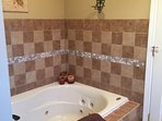 Jacuzzi tub in master bath to soak and relax in!