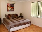 2nd king bedroom - lovely bright bedroom with air-conditioning and TV