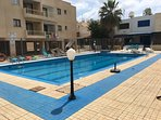 Shared swimming pool belonging to complex where there is apartment.