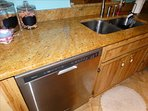BEAUTIFUL GRANITE Countertops and backsplash.  Shown here is the STAINLESS Dishwasher!