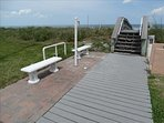 You cross over the dunes using this walkway.  Notice SHOWERS as you return, to rinse the sand off your feet!