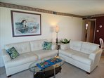 LUXURY 61 is your Vacation Paradise! Relax on the Gorgeous Couches while watching the beach outside your windows!