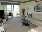 LUXURY 61 Living Room is EXACTLY what you want in an oceanfront Condo.  Notice the LARGE OCEANFRONT Balcony!