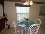 Your dining room is beautiful and the light fixture provides plenty of lighting.  Seating for all overnight guests!