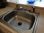 Sink features garbage disposal and sprayer to make life easier while at the beach!