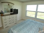 an AMAZING VIEW awaits you from the MASTER KING bedroom.  Overlooking the BEACH!