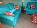 The Furniture in 702 is all NEW, and BEAUTIFUL!  Shown here:  Living Room Love Seat and Sofa.