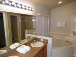 Your master bath is GORGEOUS!  Vaulted and High Ceilings complete the LUXURY Feel!