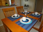 Your Dining Room Table is BEAUTIFUL and seats 4!  Additional seating for 4 in the kitchen!