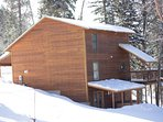 Sheltered hot tub on bottom deck.  Weber gas grill on main deck. Patio chairs provided.