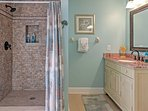 Rinse the sand off in this large walk-in shower.