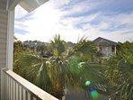 Enjoy palm tree views from the balcony.