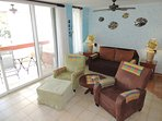 Living room has all the comforts of home: recliner, easy chair with ottoman and sofa.