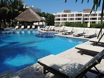 Beach pool with lounge chairs, Palapa for shade, bathrooms, rinse showers and dive gear rinse tank.