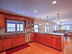 Prepare a home-cooked meal in the fully equipped kitchen with stainless steel appliances and granite countertops.