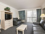 Spacious living area with sleeper sofa and sleeper love seat.