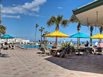 Lively outdoor pools and pool deck on the beach.