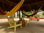 Palapa view of Hammocks Chairs across to loungers