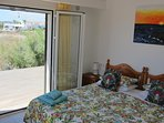 Master Bedroom has Super King bed with private wooden deck - great for yoga and stretching