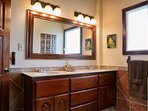 Master Bathroom Vanity showing several drawers for storage and ample lighting.