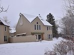 Winter view: riverfront home located in the heart of Avon-private deck and large grassy area.