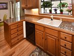 Kitchen with large bay window to private deck