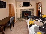 1st floor Bedroom with river views-includes trundle bed, gas fireplace, desk and TV