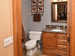 1st floor Bathroom with shower; laundry room with full-sized washer/dryer off bathroom