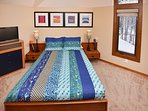 2nd floor bedroom with river views-includes full bed and TV