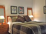 Queen guest bedroom tastefully furnished