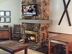 Two story granite rock 'wood burning' fireplaace in open great room