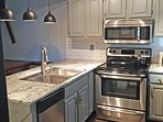 Upgraded stainless appliances including dishwasher, stove & fridge
