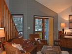 Floor to ceiling glass doors to deck provide great Taos Ski Valley mountain views