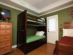 Bedroom w/ queen and set of bunk beds
