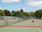 There are tennis courts in Regents Park - you can play as a visitor.