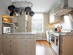 Cook's kitchen with range cooker, microwave, dishwasher & Italian granite worktops