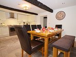 Kitchen - original oak beams, flagstone floors (heated) and a lovely entertaining space