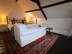 Bedroom 3 - a stunning family room with original stonework, beams and flooring.  Sleeps up to 4
