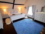 Bedroom 4 - a relaxing room with original beams & flooring.  Stunning views to Usk Valley & beyond