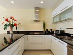 Fully equipped kitchen with toaster, blander, coffee maker, wine cooler etc.
