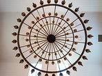 The impressive wrought iron chandelier in the Dining Hall