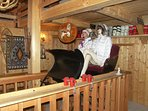 Three Bedroom Summer Option - Ladies taking a sleigh ride in stair well